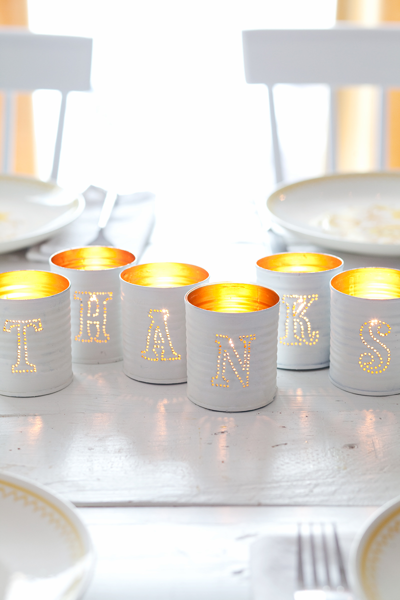 Punched tin lanterns by abeautifulmess.com